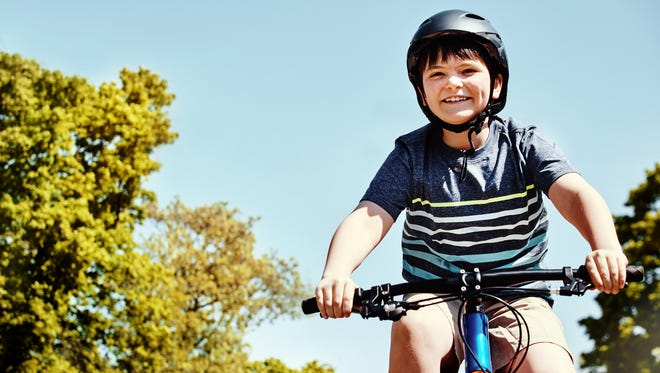 Riding a bicycle is a fun and healthy way to travel, but riders should always wear a helmet.