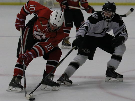 Canton junior forward Michael Tucker (left) is one of the players the Chiefs will be banking on during 2015-16.