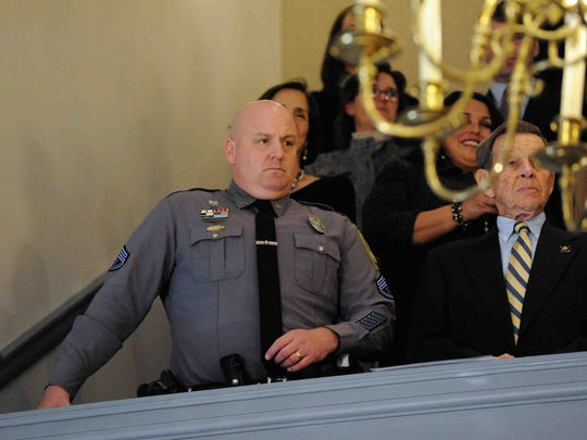 """Dover Police Master Cpl. Jeff Davis awaits the arrival of Markell. Davis recently gained fame from a viral video in which in lip-syncs Taylor Swift's """"Shake It Off."""""""