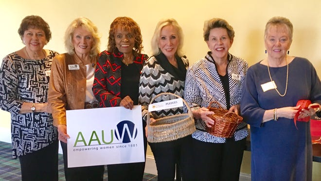 Women leaders of the American Association of University Women (AAUW) Gillian German, Sharron Cantarini, Elizabeth Nash, Sharrell Blakeley, Marsha Riley and Pat Fredericks prepare for one of their largest luncheon meetings to raise funds to send Coachella Valley girls to a STEM camp.