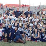 The 2015 Fairview Titan Juniors celebrate their big 28-0 Super Bowl win, posing with their championship trophies.