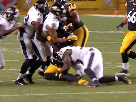 Terrell Suggs was penalized for a late, low hit.