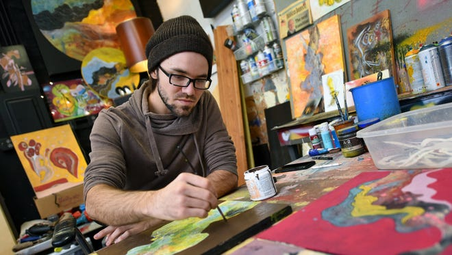 Jackson artist Clay Hardwick, founder of Turn Up Studios in Midtown, finishes up a few pieces that will be on display during Saturday's Midtown Holiday Studio Tours.