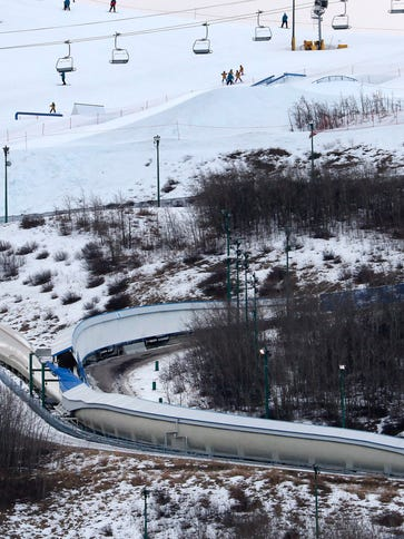 A tarp covers the intersection of the bobsled and luge