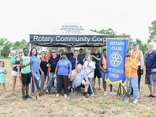 Port St. Lucie Rotary Club members aligned with members