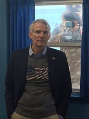 On a visit this week to the Demilitarized Zone on the Korean Peninsula, Republican Sen. Rob Portman of Ohio wears a T-shirt with OTTO, in memory of his constituent Otto Warmbier. The Wyoming man was held in North Korea for 15 months and then was returned home paralyzed and blind. He died in June 2017.