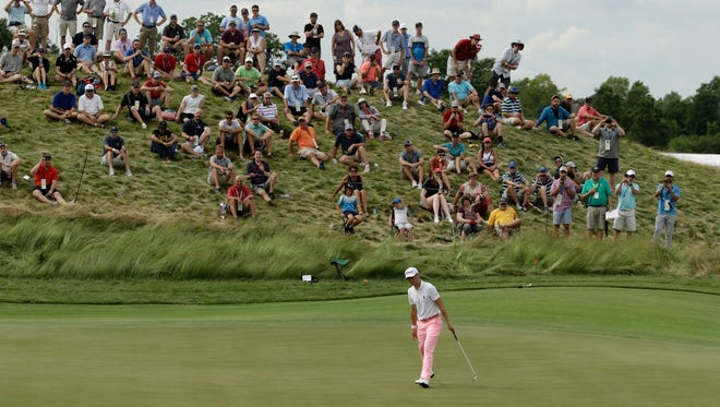 Justin Thomas makes a birdie putt on the 17th hole during the third round of the U.S. Open golf tournament Saturday at Erin Hills.