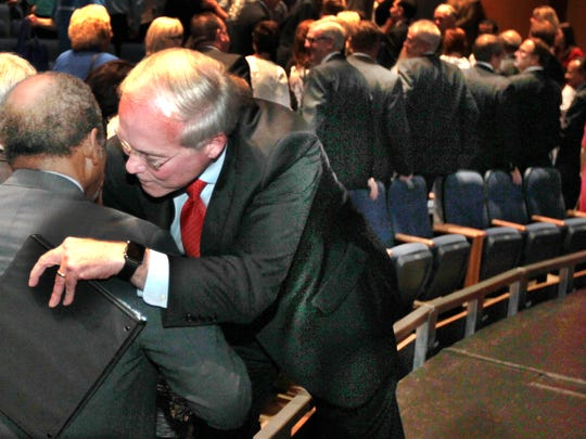 McMullen has a word with David B. Lewis, a member of