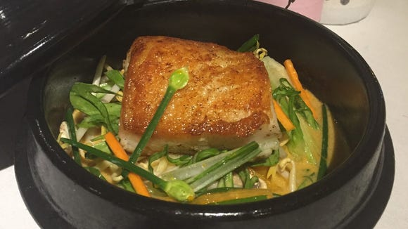 Chef Garrett Welch created this Asian-inspired butter-basted sea bass dish.