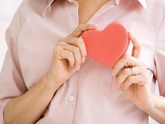 woman-holding-heart-2-410x290.jpg