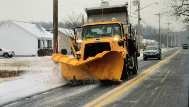 A State Highway Administration snowplow clears streets in a previous storm.