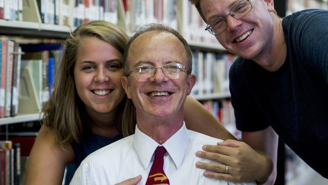 Jim Womack, who had a kidney transplant a year ago, is shown with his children Sara and Josh in Montgomery, Ala. on Tuesday August 9, 2016.