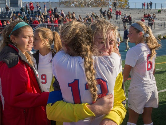 Goalie Alex Panasuk is overcome with tears as she hugs Jaime Ioro and realizes this was her last high school game. Wall ended its season Co-Champs with Northern Highlands. Wall Girls Soccer vs Northern Highlands Regional in Group III Final in Union NJ on November 19, 2016