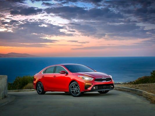 Detroit Auto Show Bigger More Fuelefficient Kia Forte Debuts - Kia car show