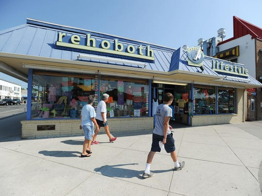 Walkers pass Rehoboth Lifestyle Clothing Co. in Rehoboth Beach on Aug. 4. Luxury clothing manufacturer and retailer Vineyard Vines is suing over a trademark issue with the store.