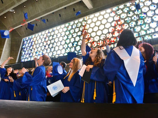 St. John's Prep graduates celebrate their graduation   Saturday during a service at the Abbey Church in Collegeville. Some attendees at high school ceremonies take issue with how others choose to express congratulations.