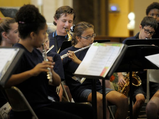 Pictured- 32 students participated in the St. Aloysius Summer Music Workshop ending with a concert Friday. The students performed a variety of music for an audience inside the St. Aloysius Catholic Church during the concert.