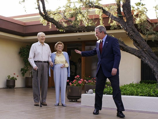 President George W. Bush (R) bids farewell to former president Gerald Ford (L) and his wife Betty outside of Ford's residence following a courtesy call April 23 2006 in Rancho Mirage.