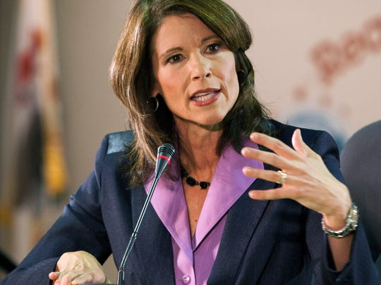 FILE - In this Oct. 17, 2012 file photo, incumbent Democratic U.S. Rep. Cheri Bustos speaks during the 17th Congressional District debate in Rockford, Ill. Bustos is running for re-election against Republican congressional candidate Bobby Schilling in the November 2014 election. (AP Photo/Rockford Register Star, Scott Morgan, File)   MANDATORY CREDIT ORG XMIT: ILROR102