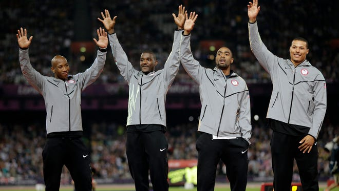 In a file photo from Aug. 11, 2012, Trell Kimmons, Justin Gatlin, Tyson Gay and Ryan Bailey celebrate after receiving their silver medals for the men's 4x100 at the 2012 Summer Olympics in London.