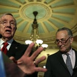 U.S. Senate Minority Leader Sen. Harry Reid (D-NV) speaks as Sen. Charles Schumer (D-NY) listens during a news briefing after the weekly Democratic policy luncheon March 8, 2016 on Capitol Hill in Washington, DC.