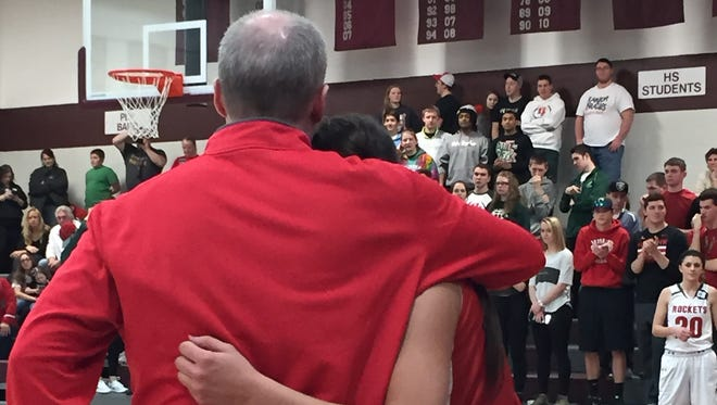 Port Clinton's Toby Bickel shares a hug with Bethany Urban during his final season as coach.