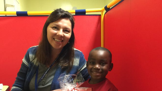 Sue Odenbrett and her ReadingPal, Brandon, celebrate the holidays. Brandon was one of several kids who received gifts from the United Way's Women's Leadership Council.