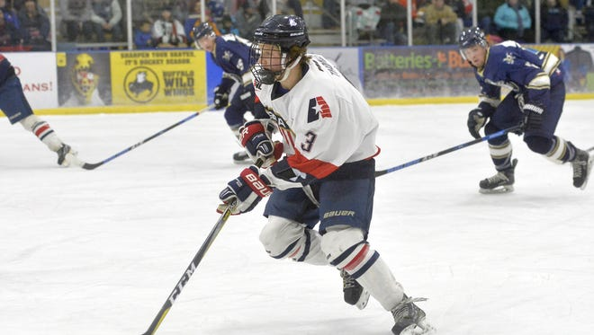 Great Falls Americans' Kody Thomas controls the puck during a recent NA3HL Frontier Division hockey match against the Yellowstone Quakes at the IcePlex earlier this season. The Americans beat Helena Friday to take over second place in the division.