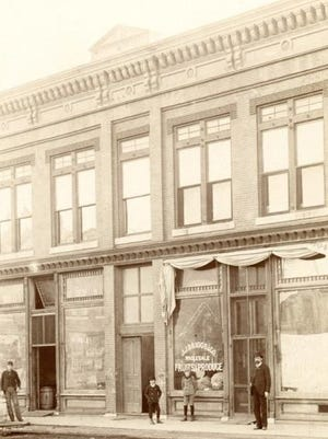In 1897, J.J. Briggs started a Wholesale Fruit & Produce Co. in Hutchinson, with Thomas Anderson standing out front.