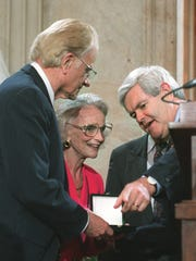 House Speaker Newt Gingrich, of Ga., presents Evangelist