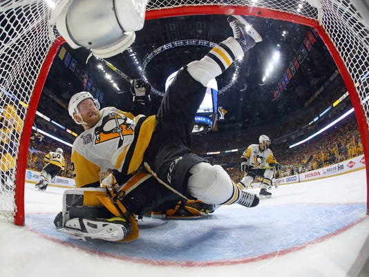 Pittsburgh Penguins defenseman Chad Ruhwedel (2) falls over goalie Matt Murray during the periodagainst the Nashville Predators in Game 4 of the NHL hockey Stanley Cup Final Monday, June 5, 2017 in Nashville, Tenn. (Bruce Bennett/Pool Photo via AP)