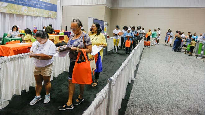 A scene of the line for free health screenings during the Black Expo Health Fair at Indiana Convention Center on Thursday, July 19, 2018.