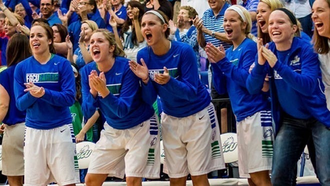 Carolina Day graduate Haley Laughter, second from left, plays for the Florida Gulf Coast women's basketball team.