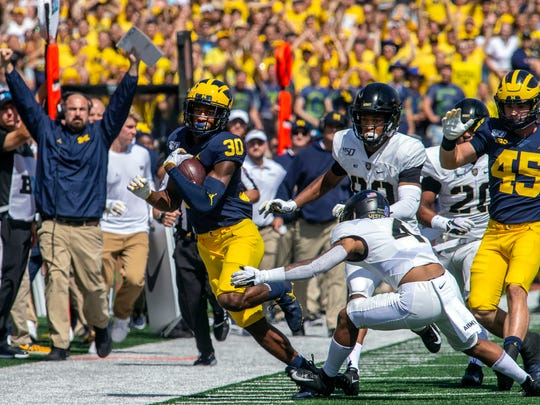 Michigan defensive back Daxton Hill (30) rushes 25 yards past Army defensive back Akyah Miranda (4) for a first down in the first quarter of an NCAA football game in Ann Arbor, Mich., Saturday, Sept. 7, 2019. (AP Photo/Tony Ding)