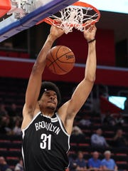 Brooklyn Nets center Jarrett Allen dunks during the first half of an NBA preseason basketball game against the Detroit Pistons, Monday, Oct. 8, 2018, in Detroit. (AP Photo/Carlos Osorio)