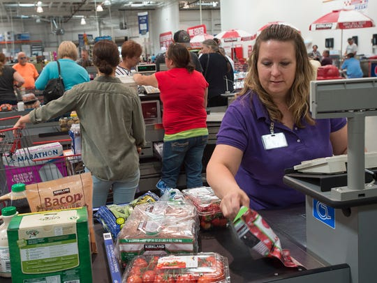 Terri Adkins rings up items for a customer at Costco