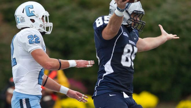 Monmouth University's Zach Fabel, shown here scoring a touchdown against Columbia in 2014, has dealt with injuries the last two seasons, but will start against Lehigh on Saturday afternoon in the season-opener