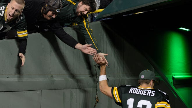Green Bay Packers quarterback Aaron Rodgers (12) walks into the tunnel following the Packers victory.