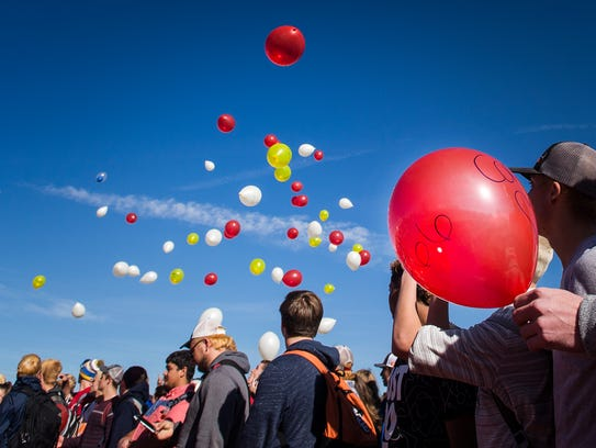 Poudre High School students release balloons Nov. 14, 2017, at Poudre High School in Fort Collins. The balloons were in memory of student Joshua Cortez and his mother, Kelly Cortez, who were killed in a car crash Nov. 9 while leaving a football team dinner.