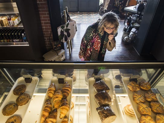 First-time customer Laurie Koralewski looks over a