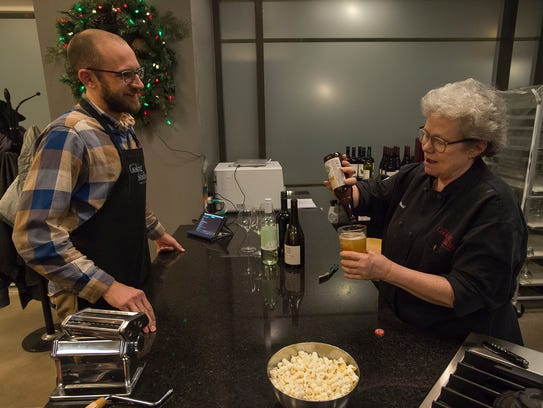 Owner of The Cooking Studio Trish O'Neill pours Max