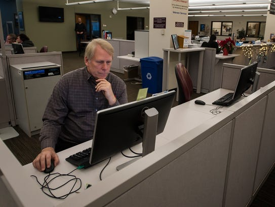 Michael Windstorm uses computers at the Larimer County Workforce Center in Fort Collins to take an online course before searching for a job in sales or production management on Friday, Jan. 5, 2018.