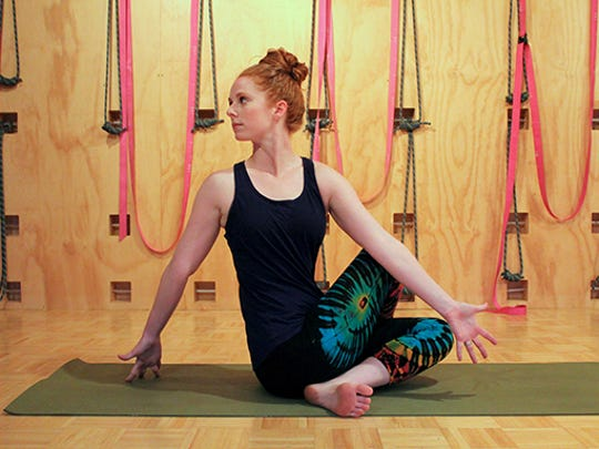 Yoga instructor Meghan McMillan twists as part of her practice. Twists are great for digestion, detoxing. spinal alignment and relieving back pain and shoulder and upper back tension.