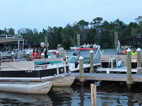 Boats are docked for a Bands on the Blackwater concern