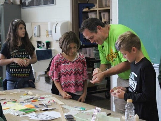 Fifth-grade students learn about building rockets with