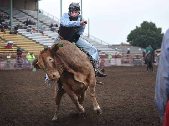 Professional Rodeo Cowboys Association bull rider Ryan Knutson, from Toronto, South Dakota, rides in the PRCA Rodeo Monday, Aug. 13, at the Sioux Empire Fair in Sioux Falls.