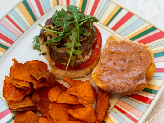 The Boursin Burger, topped with grilled onions and arugula, the bun spread with a chipotle mayo mixture, was runner-up in the Wisconsin BBQ Recipe Contest.