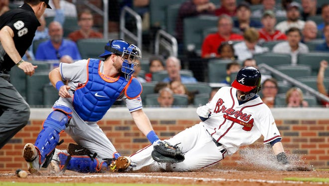 May 2, 2017; Atlanta, GA, USA; New York Mets catcher Travis d'Arnaud (18) tags out Atlanta Braves shortstop Dansby Swanson (7) at home plate in the sixth inning at SunTrust Park. Mandatory Credit: Brett Davis-USA TODAY Sports
