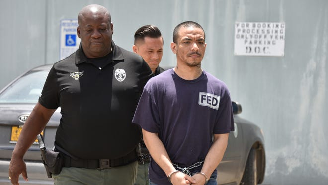In this file photo, Shawn Paul Johnson is escorted by Department of Corrections officers to the Guam Police Department Hagåtña precinct upon his arrest on the latest DOC contraband case on Tuesday, Sept. 5, 2017. Johnson and another inmate Bruno Simmons were arrested after a shakedown of the prison over the weekend, according to police.