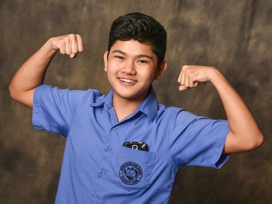 Notre Dame High School senior, Paulo Dela Cruz, 16, poses for a photo at the Pacific Daily News studio in Hagatna on Monday, Aug. 31.
